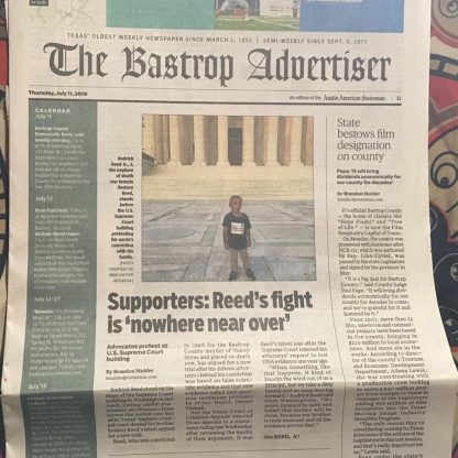 RJ Reed's picture on the front of The Bastrop Advertiser