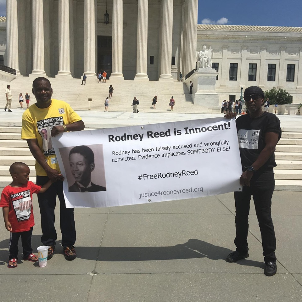 Reed family in front of Supreme Court of the United States