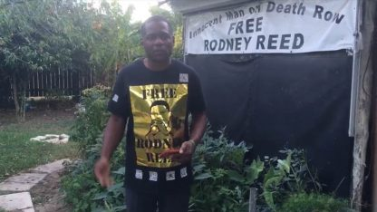 Rodrick Reed in front of Free Rodney Reed banner